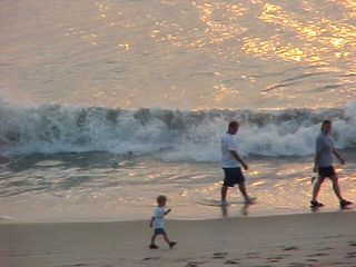 And even at this early hour, there are people waking their children up to go walking along the beach!