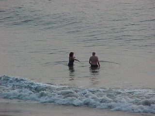 And all the while, a couple gets in the water, and prepares to have some fun.