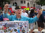 A man sells political buttons relating to historical political figures and current events.