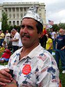 A man wears a tinfoil hat.