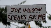 """""""Joe Wilson speaks for me"""" sign attached to the top of a flagpole. This refers to Congressman Joe Wilson's """"You lie!"""" outburst during a speech by President Obama in a joint session of Congress."""