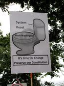 """A poster's message advocates resetting the system by """"flushing"""" Washington."""