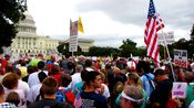 Crowd on the west side of the Capitol, as far back as First Street.