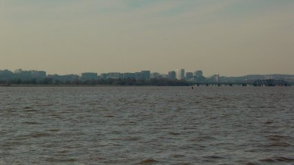Looking across the Potomac River, one can catch a glimpse of the Virginia side of the Potomac, with Arlington County (Rosslyn neighborhood pictured here), and the City of Alexandria in clear view.