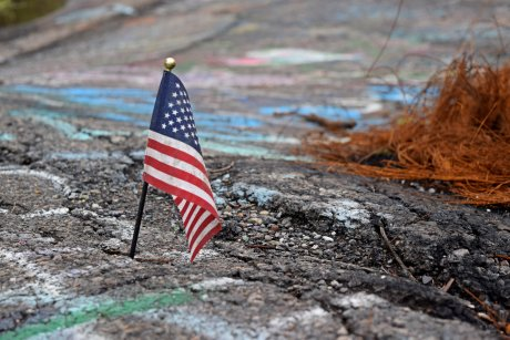 An American flag, placed in a crack in the pavement of the Graffiti Highway in Centralia, Pennsylvania.