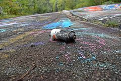 Discarded spray paint can on the Graffiti Highway in Centralia, Pennsylvania, likely used for tagging the road.