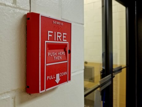 Siemens fire alarm pull station in Armstrong Hall, a building on the campus of West Virginia University in Morgantown, West Virginia.