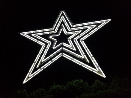 The Roanoke Star, lit in white on May 31, 2018. Several sections of the star's tubing are out.