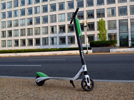 Lime Scooter parked on the sidewalk on Independence Avenue SW in front of the National Air and Space Museum in Washington DC.