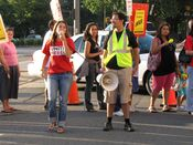 Two people stood in the center of the picket area, and shouted chants into a bullhorn.