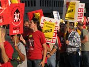 Demonstrators walk the picket lines outside the Hilton Crystal City.