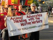 """Two people carry an """"Animal Advocates Standing with the Hilton Workers"""" sign. This was the only sign that went somewhat off-message."""