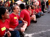 In the picket's final stage, a row of people sat in the street with locked arms as part of a civil disobedience action.