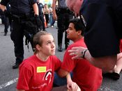An Arlington Police officer tells a demonstrator that she will be arrested if she remains in the street.
