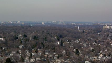 In the distance is Arlington. If you click on this picture to zoom in, you can get a fairly good view of Arlington's Rosslyn neighborhood in the center of the picture, with another Arlington neighborhood to the left (anyone know which one this is?). This is a good example of how Arlington's various business districts are situated, as little clusters of high-rise buildings. Note in the Rosslyn Neighborhood the Rosslyn Twin Towers, from the early 1980s, formerly the home of Gannett News. These two buildings are Arlington's tallest.