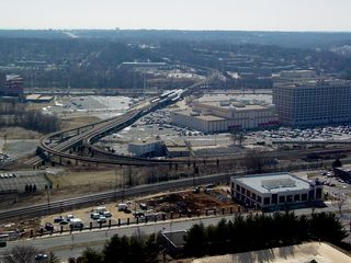 One thing of interest to note is that Metro is able to operate above ground for almost its entire length in Alexandria, as seen here at the Eisenhower Avenue station seen here, and the Huntington station off in the distance.