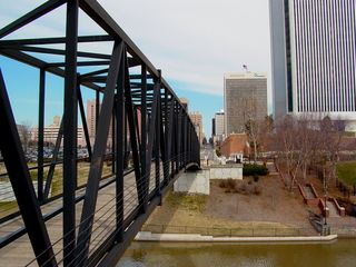 The business district and the canal and beyond are connected by a large pedestrian bridge spanning the canal.