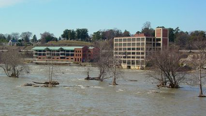 Past the Belle Isle bridge, the business district is over, as more spaced-apart low-rise buildings predominate.