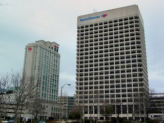 """Just like in Richmond, there's a Bank of America Building, and the two do bear a bit of a resemblance. However, in Norfolk, the windows are sunken into the building somewhat, instead of at the edge of the building. Additionally, if you look carefully at the top of this building, you can see the outline of """"SOVRAN"""" etched in the building wall, left over from when it was called Sovran Center, after Sovran Bank, a predecessor company to Bank of America."""