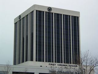 The First Virginia Tower is a tower with another tower rising out of it. The second through seventh floors are parking facilities, while the actual office tower is above.