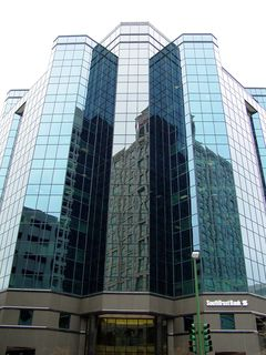 The Main Street Tower, a postmodern building built in 1994 and home to SouthTrust Bank offices, has a unique look in Norfolk. To me, it almost appears that the building is wearing a vest, with the two projections on either side of the main corners.