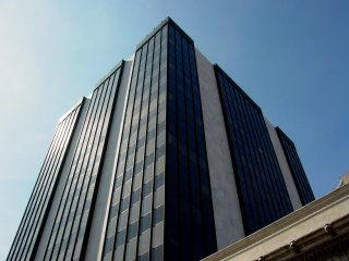 """In Roanoke, if you wanted to put a name on the skyline in early 2003, you would probably say that First Union owned the skyline. The two tallest buildings both had """"First Union"""" at the the top of them. This one, the smaller of the two, is the First Union Building, built in 1973. It appears to have been built onto a previous First National Exchange Bank building, which is a different style from the tower next to it. First Union's dominance of the Roanoke skyline would, however, end within three months of this set's being made, as the merger between First Union and Wachovia would be finalized in the spring of 2003."""