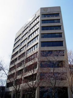 """Also nearby is SunTrust Plaza. Making this building distinct is the picture of what appears to be a head wearing a hat at the top of the building, likely a remnant of a previous company to use this building, similar to the Bank of America Building in Norfolk's having """"SOVRAN"""" etched into the top of it."""