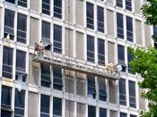 June 1, 2008: Crews in protective gear work on the outside of the building's east side.
