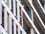 August 6, 2008: A worker removes columns from the curtain wall, east side.