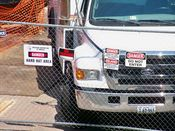 August 6, 2008: Perimeter fence along North Fort Myer Drive, with warning signs posted.