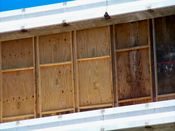 September 7, 2008: Plywood covers help control dust during the demolition of the tenth floor slab.