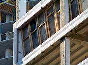 September 7, 2008: Southwest corner. Plywood prevents the spread of dust from floor slab demolition.
