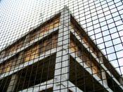 September 27, 2008: Southeast corner of building viewed through metal screening on the Rosslyn Center sidewalk shed.