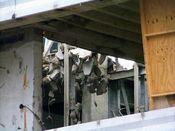 September 27, 2008: Chunks of concrete dangle from steel rebar during floor slab demolition.