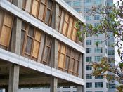 September 27, 2008: Southeast corner of building, with plywood covers used to contain dust.
