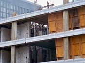 September 27, 2008: Concrete dangles through what appears to be the former elevator shaft at the fifth and sixth floor levels.