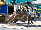 October 4, 2008: A man inspects the head of the long reach excavator.