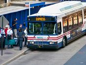 October 4, 2008: The 5A express bus to Dulles Airport services its stop from the sidewalk shed.