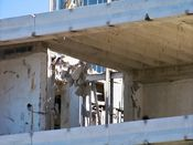 October 4, 2008: Chunks of concrete dangle from steel rebar at the sixth floor level.