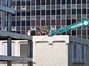 October 4, 2008: The head of the long reach excavator approaches part of the fourth floor slab.
