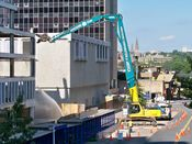 October 4, 2008: Long reach excavator at work, preparing to demolish part of the fourth floor slab.