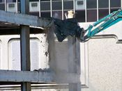 October 4, 2008: The long reach excavator crushes part of a reinforced concrete beam.
