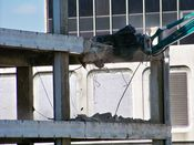 October 4, 2008: The long reach excavator crushes through part of the floor slab.