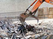 October 13, 2008: An excavator prepares to grab another load of scrap metal.