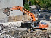 October 13, 2008: An excavator carries a small amount of scrap metal, to place in a dumpster.