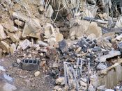 October 13, 2008: Bits of rebar, concrete, and other debris on the ground.