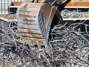 October 13, 2008: An excavator grabs a large pile of steel rebar.