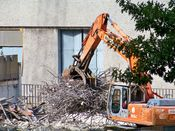 October 13, 2008: An excavator moves a pile of steel rebar.