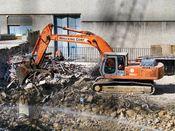 October 13, 2008: An excavator prepares to grab a pile of scrap metal.