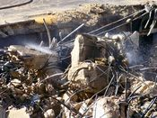 October 13, 2008: Water is sprayed on a pile of concrete debris and scrap metal.